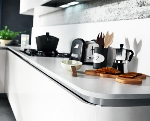 Cuisine Armony - Détail de l'arrondie du meuble terminal et du plan de travail.