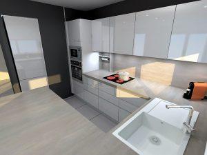 La hotte se trouve dans le meuble au dessus de la plaque, cela permet d'avoir une uniformité entre meubles bas et hauts